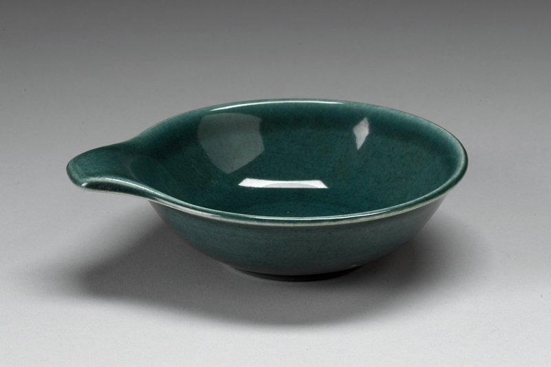 small footed bowl with flat handle; green glaze