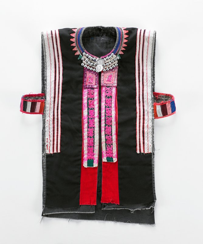 vest to be worn over coat (2003.243.28.1.2); black and grey body; strips under arms with open sides; metal studs and coin buttons at collar; multicolored applique stripes under arms and on back; pink, maroon, green and white embroidered bands at front opening