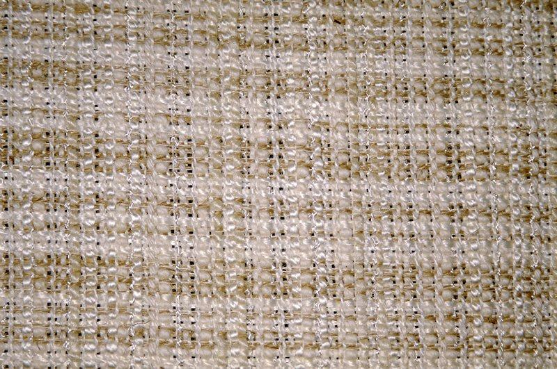 Variation on a plain weave:some thin and thick warp. Over dyed fabric. Natural