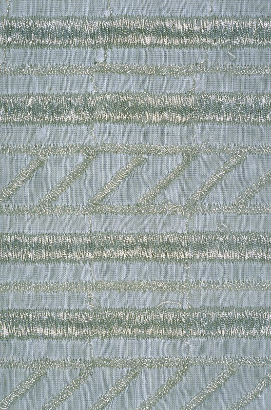 Description Metallic embr. sheer. Aluminum gimp embroidered over Dacron scrim in heavy vertical stripes separated by thinner metallic lines. Metallic embr. sheer. Aluminum gimp embroidered over Dacron scrim in heavy vertical stripes separated by thinner metallic lines. Burnished Silver