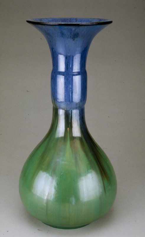 vase, earthenware with bulbous lower body, elongated banded neck and outflared rim, Chinese blue and green lustre glaze