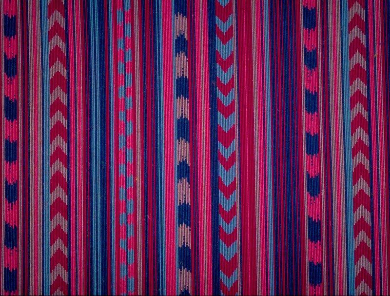 "Repp weave Vert. Stripe of varying widths, some with chevrons. Vert. Rpt. 5""; horiz. Rpt. 12"". Shades of red & blue Aubergine"