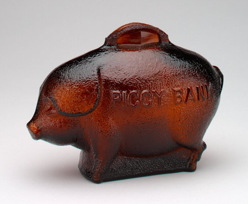 brown glass standing pig; floppy ears; on each side of pig, printed in raised letters: 'Piggy Bank'; raised coin slot on back of pig