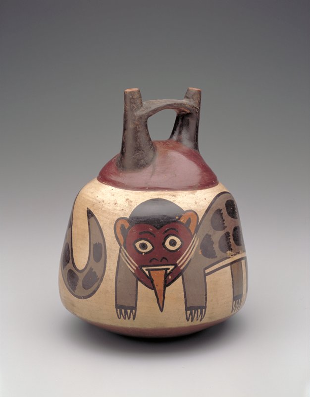 Double-spout vase with a band carrying two Pumas painted in polychrome on a white ground. Note the spotted body of the Puma and the long projecting tongue, characteristic of this beast in Nazca pottery and textiles.