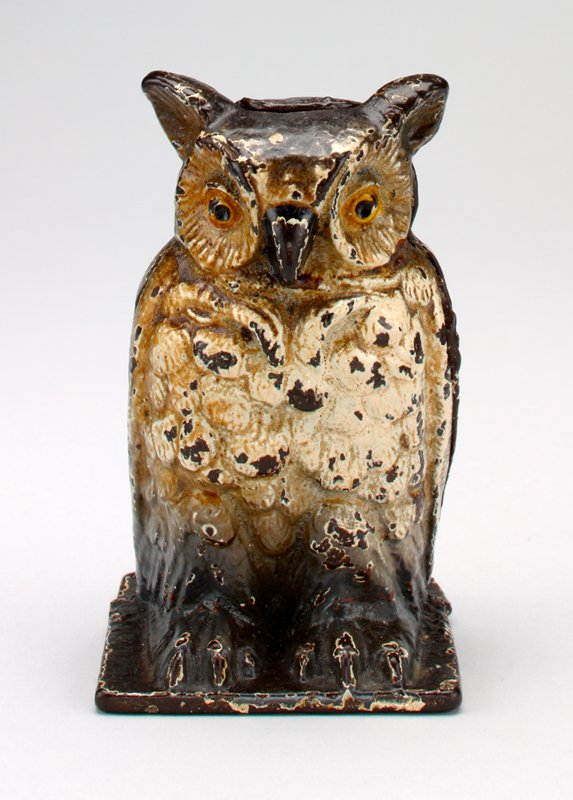 brown owl w/ white/tan breast feathers; gold around eyes- coin slot in back of head