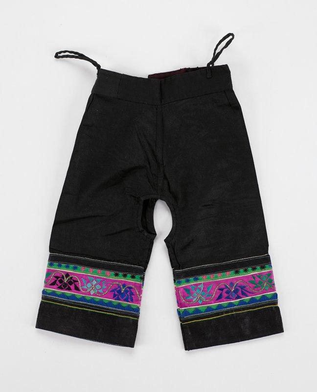 """black cotton unlined except for bottom 4 1/2""""; pounded cuffs and pink embroidered bands with blue ric-rac; two pair of narrow ties"""