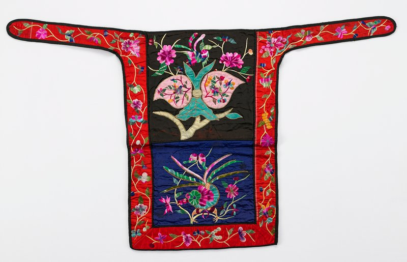 black and blue brocade silk with red border on coarse weave backing; flat embroidery of birds, butterflies and flowers in green, dark pink and yellow; edges highlighted in narrow gold braid