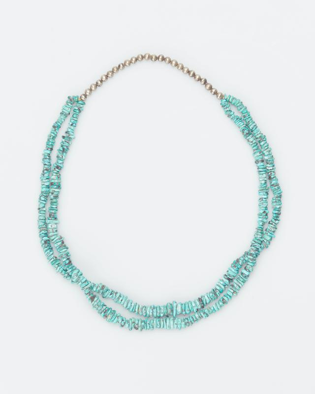 double strand of small turquoise nuggets and single row of silver beads at top