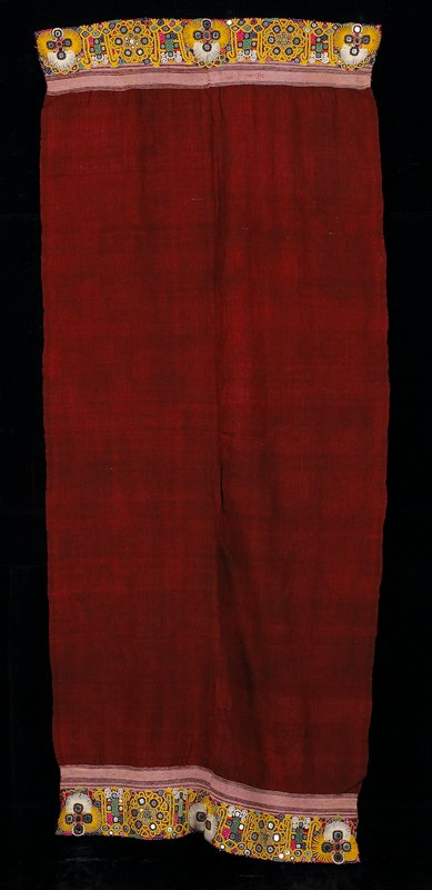 """dark red with center seam; 7 to 7-1/2"""" wide, yellow embroidered borders with mirror designs at both ends; two selvedges; finished hems at both ends"""
