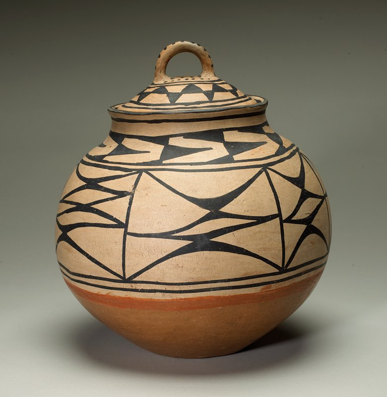 bulbous bodied vessel with concave base; shoulder, mouth and cover are light tan with black geometric designs; red stripe on body below decorated area