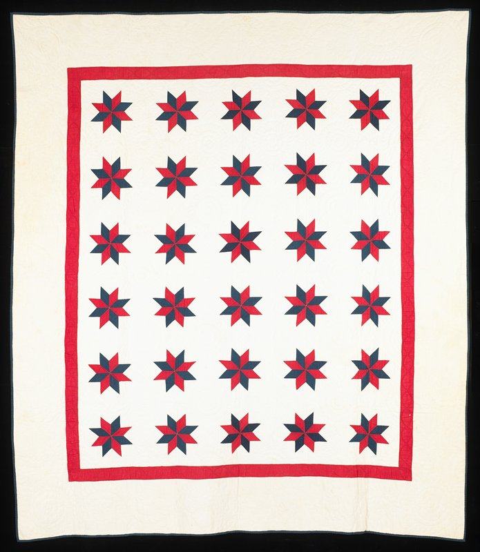 red and blue with white backing and background; thirty blue and white stars with red border; scalloped circular quilted designs alternate with stars; scrolling leaf and flower quilted borders