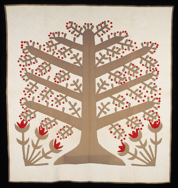 appliqué; grey tree with eight large branches, numerous small branches and cherries on embroidered stems; six red flowers in lower corners; white ground and background