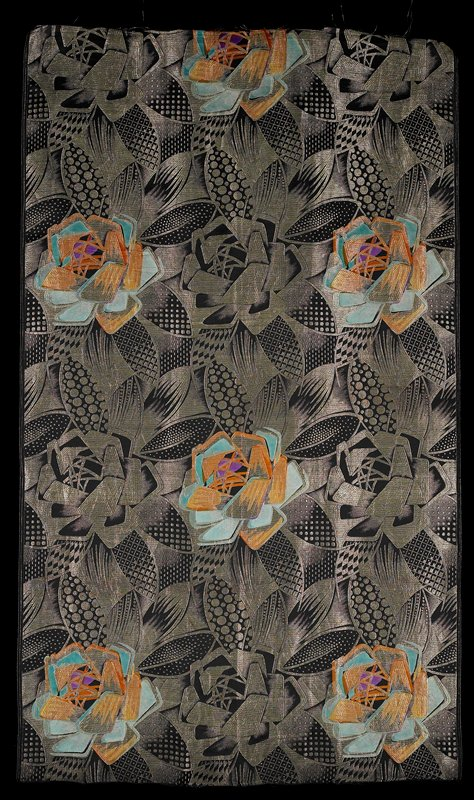 jacquard woven; gold on black with sections in orange, turquoise and purple; repeating abstract flower and leaf pattern