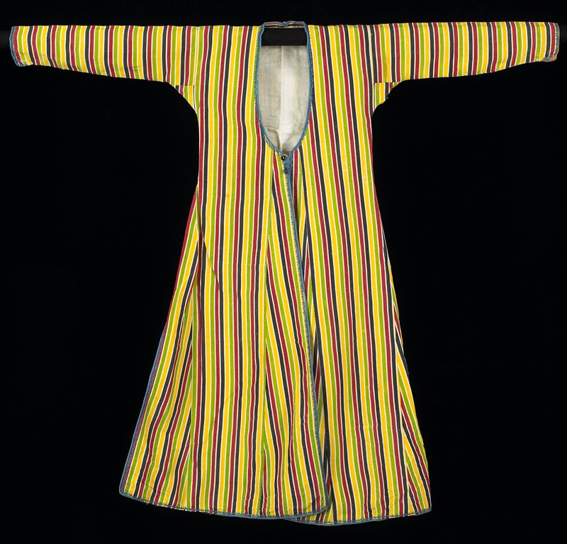 striped (yellow, green, red and black) silk coat; blue braided cord and thin cord trims; two buttons on front; long vents on sides bound in braid; lining tacks show on back; off-white cotton lining