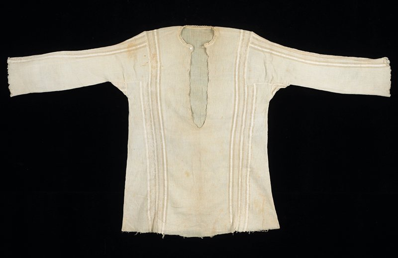 button front at neck with loop closure; plain ecru woven vertical stripes, front, back and sleeve; tatting at sleeve ends and front opening; rickrack around neck; bottom edge unfinished