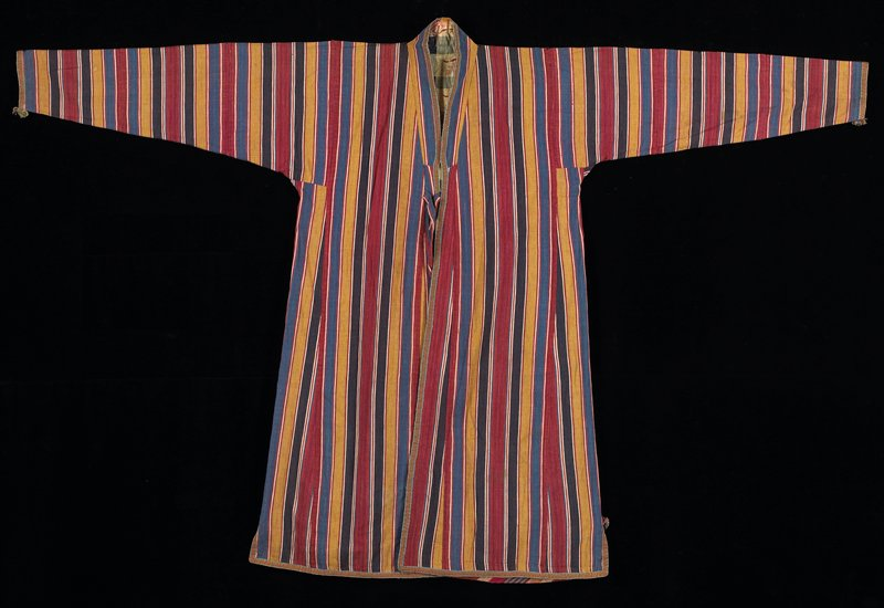 multicolored vertical stripe cotton in yelllow, red, blue and black; front opening bound in woven tape; side slits, long sleeves, ties at waist; opening faced with Ikat, lined in blue/white plaid; lining stitched to garment