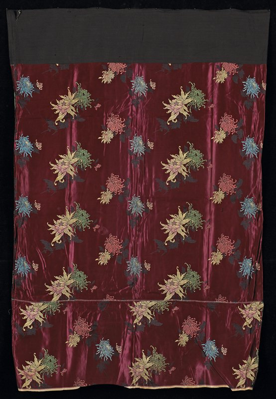 """woven overall chyrsanthemum pattern on burgandy silk field, in green, blue, pink and off-white; 10-1/2"""" addition on bottom; black cotton waistband"""