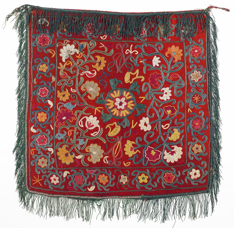 Fringes with warp-twined (LM) headings, Pieced, printed lining Brushed red wool ground with polychrome silk embroidery. There are two different fringes on the edges; one, on the top and PL, is all silk; the other, on the bottom and PR, is silk and cotton. The backing is pieced from two printed cotton fabrics. There are two intact hanging loops. Chain stitch dominates.