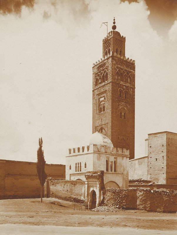 square tower with minaret at top; square domed building in front of tower; Morocco