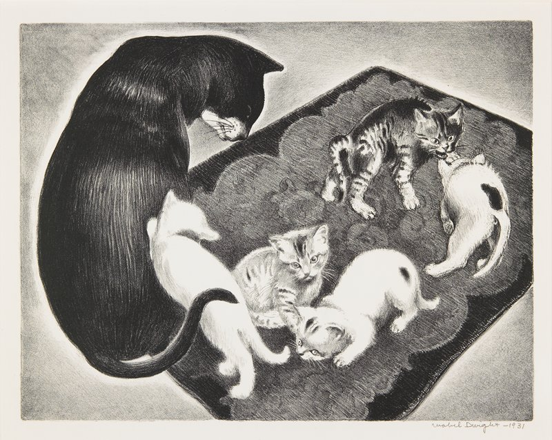 black and white mother cat, seated, with five kittens in various poses (two tiger, one white, two white with black spots) on a small rug