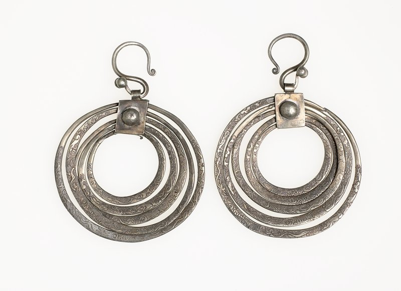 each earring consists of five graduated hoops; hoops incised with flowers, fish and dragons; ornate S-shaped hooks