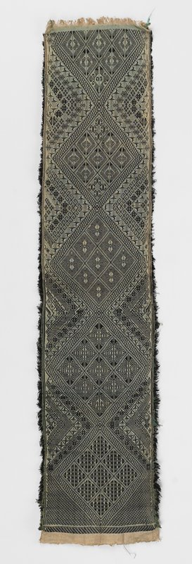 appears to be woven, not embroidered, in black, green and tan; not hemmed