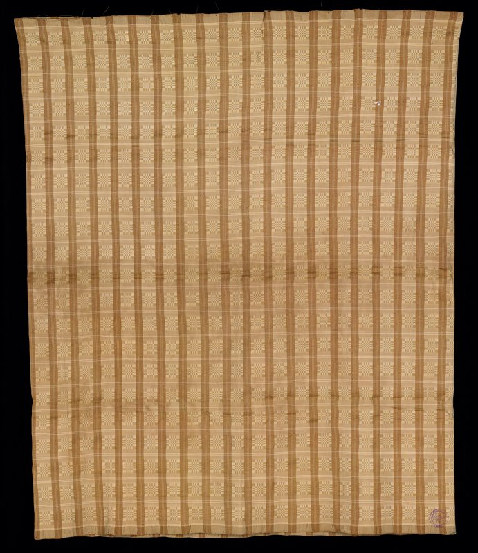 light brown vertical stripes with light gold horizontal checkerboard-like patterns; joining seam is flat felled seam