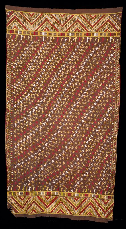 "brown rectangle embroidered overall with approximately 10"" borders top and bottom in chevron design; hand woven cotton with silk embroidery in red, gold, green and white; three sections hand stitched together"