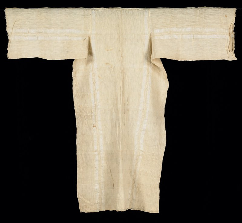 long silk ecru garment; underarm and side panels are of one piece forming gusset-like structure; long wide sleeves have small crocheted finish; apparently unfinished--no neck hole