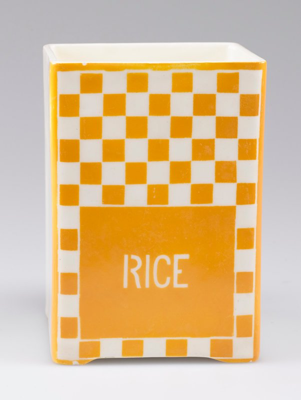 "open square container; porcelain with one side decorated with yellow-orange and white checkerboard and ""RICE"" in white"