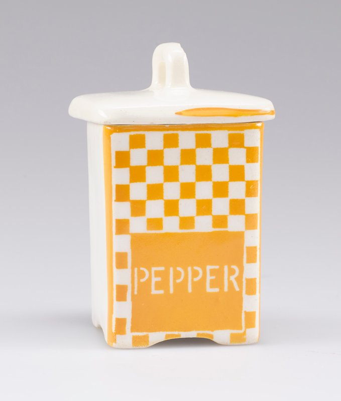 "small square container with cover with small handle; white porcelain decorated with yellow-orange checkerboard and ""PEPPER"" in white on front; stripe around edge of cover on front and sides"
