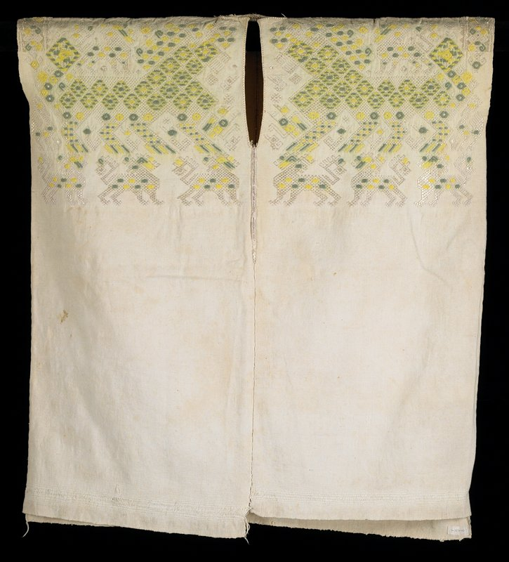 "coarse woven white cotton; top, front and back have supplementary weft silk designs including animals; some areas are embroidered over with green and yellow cotton threads forming diamonds; color areas are a secondary, supplementary weft; original color of silk was light mauve; slit neck and 6 3/4"" of center seam stitched with silk; PL piece shorter than PR"