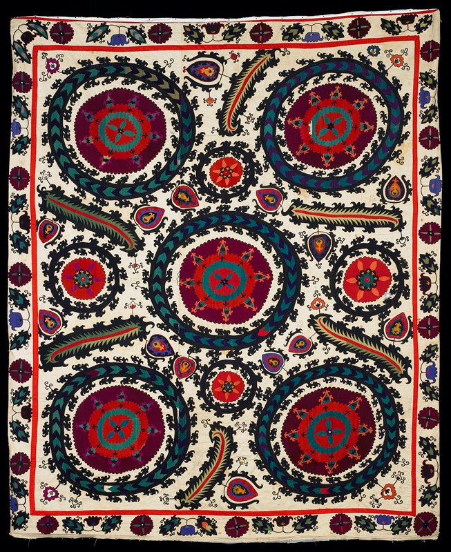 three ecru cotton panels embroidered and sewn together; five large round motifs; six leaf shaped motifs; floral motifs embroidered with black, purple, red, green, blue, mauve and ochre; all around a narrow red gadroon and out border with floral motifs; embroidered with the same stitches