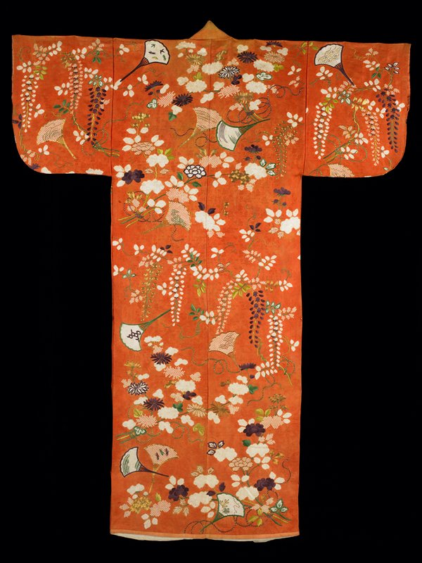 orange ground; white undyed areas forming leaves, flower and fans, accented with green, gold and purple embroidery; white lining